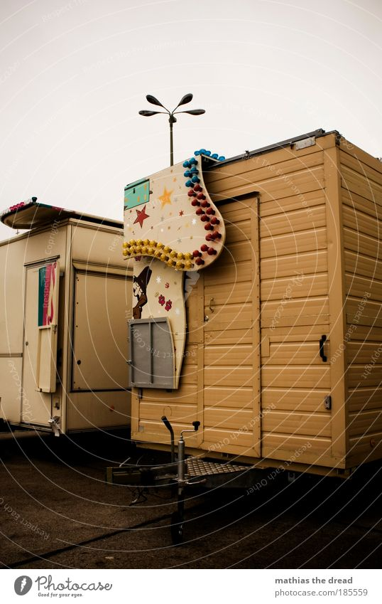 THE CARNIVAL IS OVER. Sky Clouds Bad weather Deserted Road traffic Street Vehicle Mobile home Caravan Old Gloomy Badlands Camping Stalls and stands