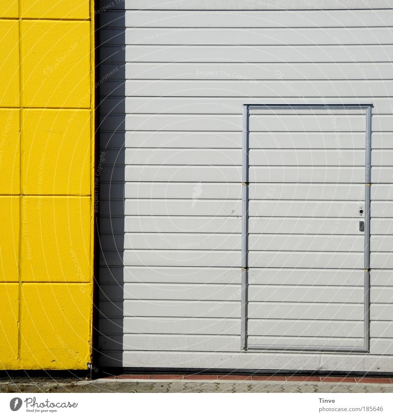 note entrance Industrial plant Building Wall (barrier) Wall (building) Facade Door Yellow Gray Striped Checkered Entrance Front door Way out Rolling door
