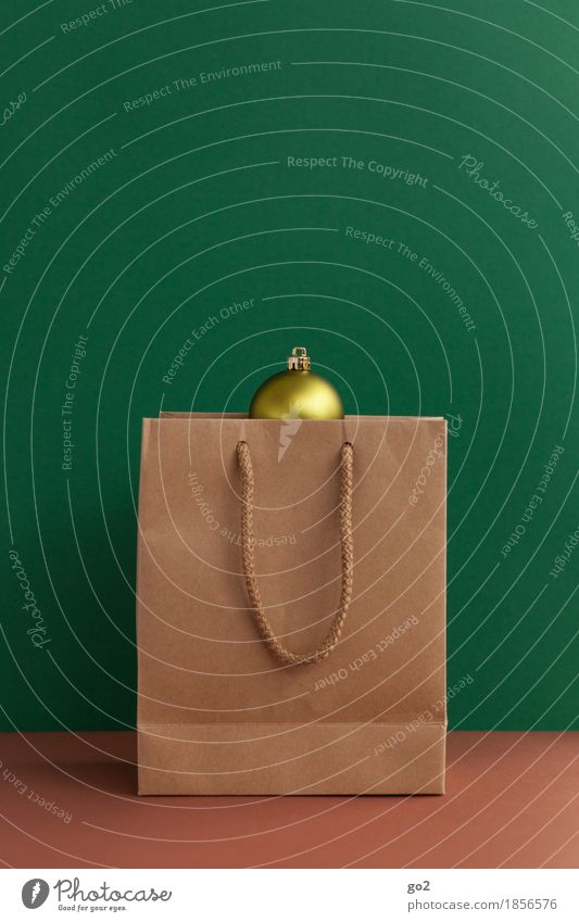 Christmas present Shopping Christmas & Advent Decoration Paper bag Bag Gift Brown Yellow Green Trade Glitter Ball Colour photo Interior shot Studio shot
