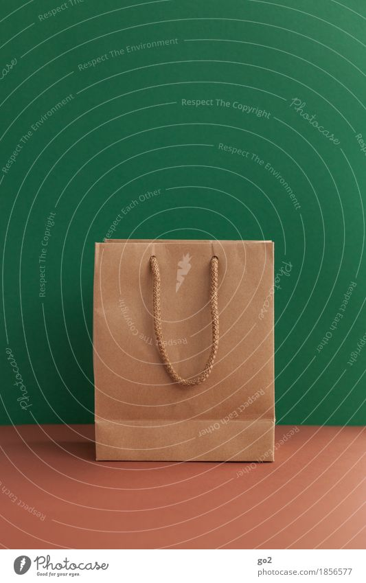 gift bag Shopping Christmas & Advent Paper bag Bag Gift Brown Green Trade Empty Colour photo Interior shot Studio shot Close-up Deserted Copy Space left