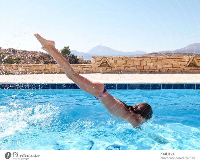 Young girl takes a header into swimming pool Summer Swimming pool Swimming & Bathing Headfirst dive Feminine Child Body 1 Human being 8 - 13 years Infancy Water
