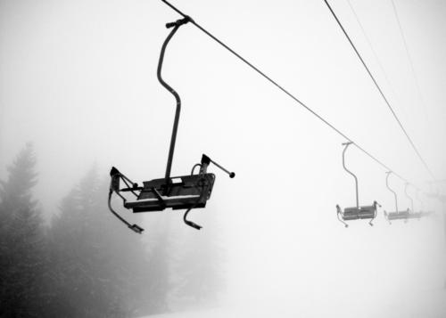 descent Skis Ski run Chair lift Nature Winter Fog Snow Snowfall Alps Mountain Cable car Ski lift Freedom Black & white photo Exterior shot Deserted Contrast
