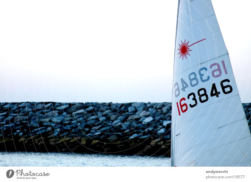 wind sailing Watercraft Ocean Lake Break water Coral Air Digits and numbers Navigation Sail Wind Rock Stone