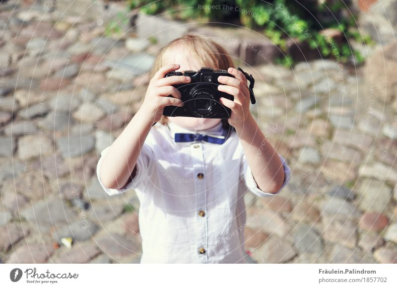 Photographer. Masculine Child Boy (child) Infancy 3 - 8 years Art Artist Event Media Print media Film industry Video Shirt Bow tie Small Cool (slang) Eternity