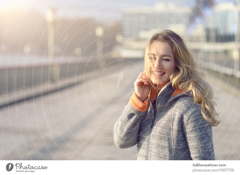 Happy woman with a joyful smile Lifestyle Joy Face Freedom Sun Winter Woman Adults 1 Human being 18 - 30 years Youth (Young adults) Nature Autumn Wind Town