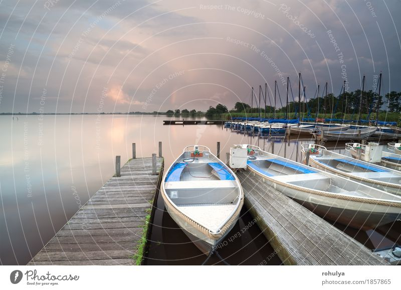 boats and yacht by pier on big lake Nature Landscape Sky Clouds Rain Pond Lake Harbour Yacht Watercraft Wood Fitness Adventure Jetty water Sunset Vantage point
