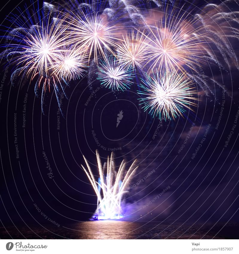 Colorful fireworks with water reflection Sky Blue Christmas & Advent Colour White Red Joy Dark Black Freedom Feasts & Celebrations Party Lake Orange Bright Waves
