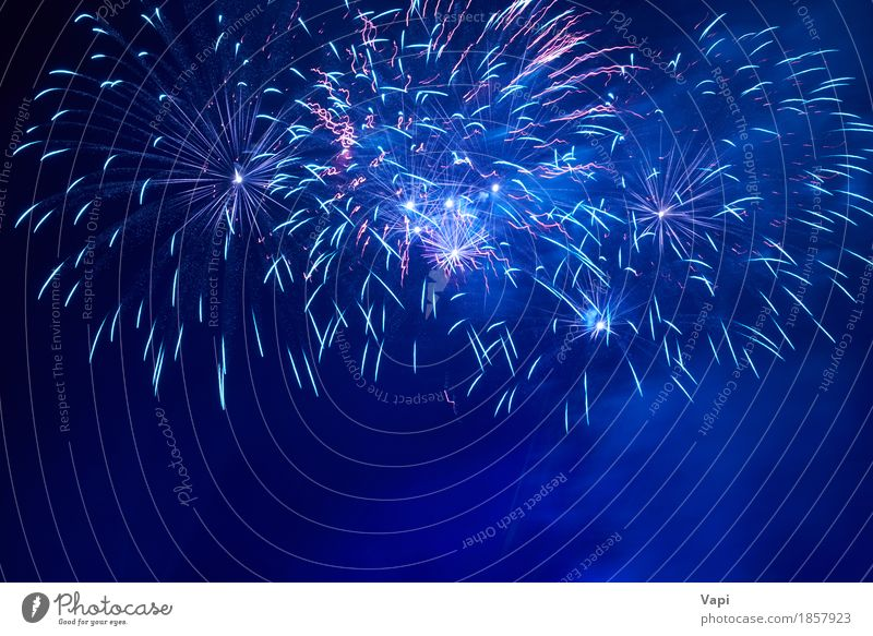Blue colorful fireworks Joy Freedom Night life Entertainment Party Event Feasts & Celebrations Christmas & Advent New Year's Eve Art Shows Sky Night sky Dark
