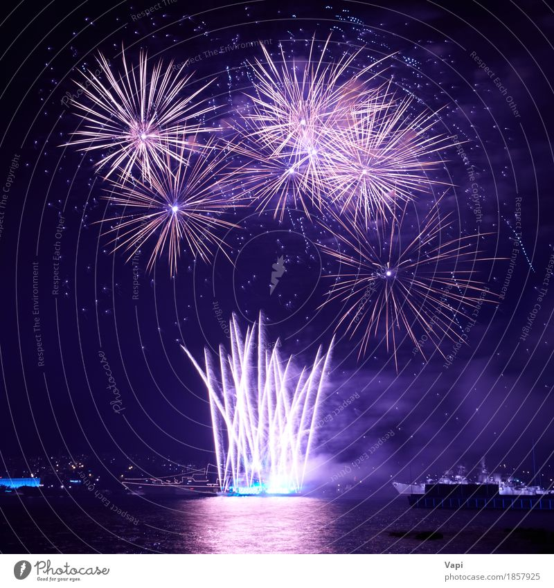 Blue colorful fireworks on the black sky with water reflection Sky Blue Christmas & Advent Colour White Red Joy Dark Black Freedom Feasts & Celebrations Party Lake Bright Waves Violet