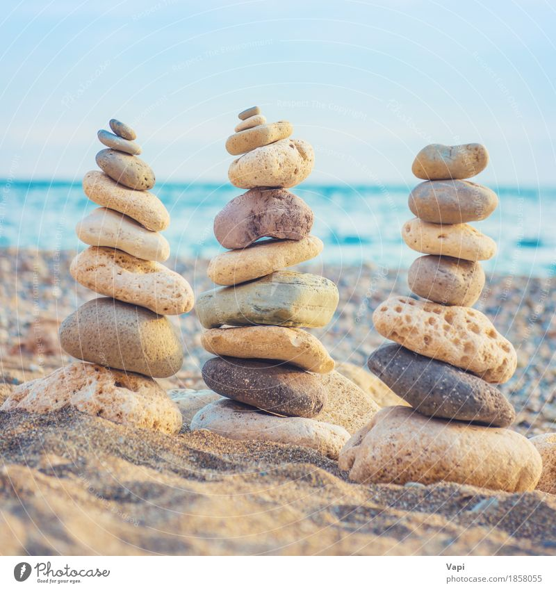 Three stacks of round smooth stones Sky Nature Vacation & Travel Blue Summer Water White Ocean Landscape Relaxation Beach Environment Yellow Coast Art Gray