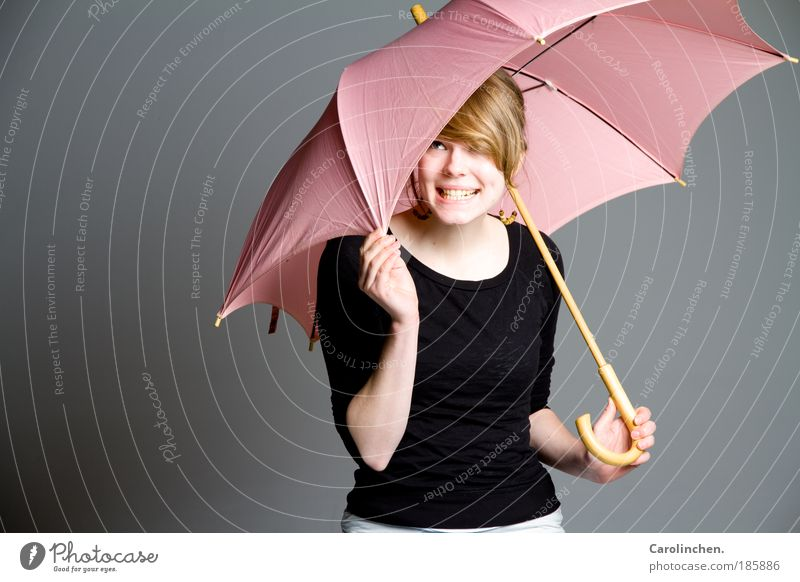 Umbrella. Umbrella. Feminine Young woman Youth (Young adults) 1 Human being 18 - 30 years Adults Rain Sweater Earring Blonde Long-haired Bangs Smiling Laughter