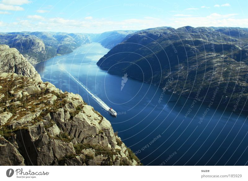 Happy birthday, Photocase! Fjord Lysefjord Ocean Norway Scandinavia Calm Mountain Loneliness Blue Coast Slope Rock Gravel Water Free Freedom Clouds Sky Nature