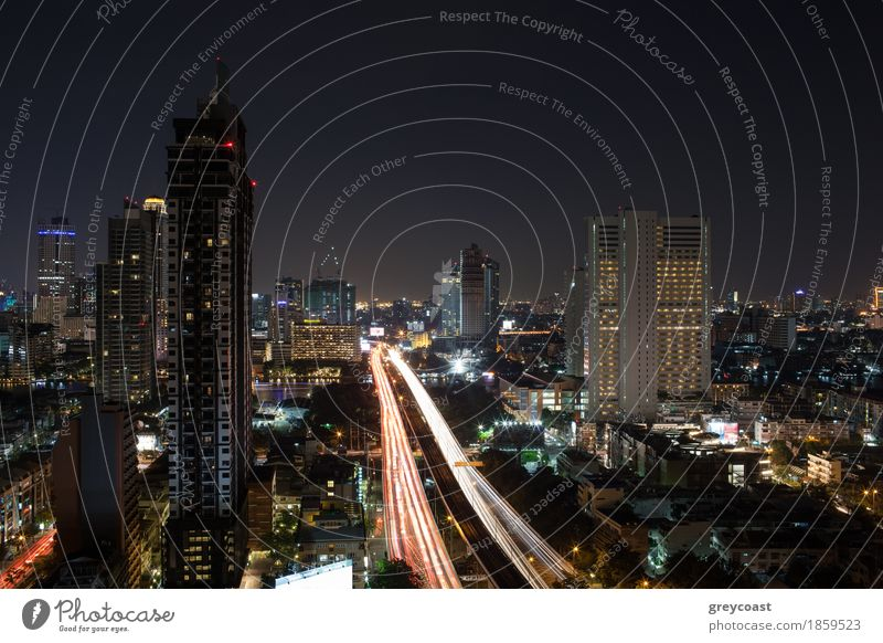 Night cityscape of Bangkok, Thailand capital. View to the illuminated buildings and busy motorway River High-rise Bridge Building Architecture Transport Street