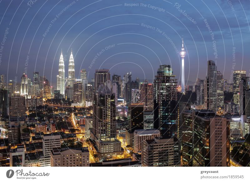 Night shot of Kuala. Panorama with city architecture and transport. Malaysia capital view with Petronas Towers and Menara Tower Town Capital city