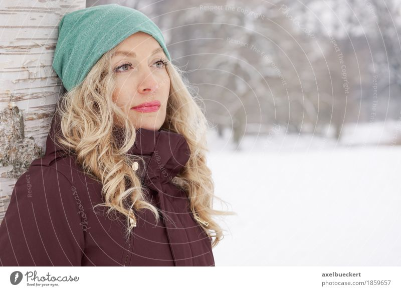 woman leaning against tree in winter Lifestyle Winter Snow Human being Feminine Young woman Youth (Young adults) Woman Adults 1 30 - 45 years Nature Landscape