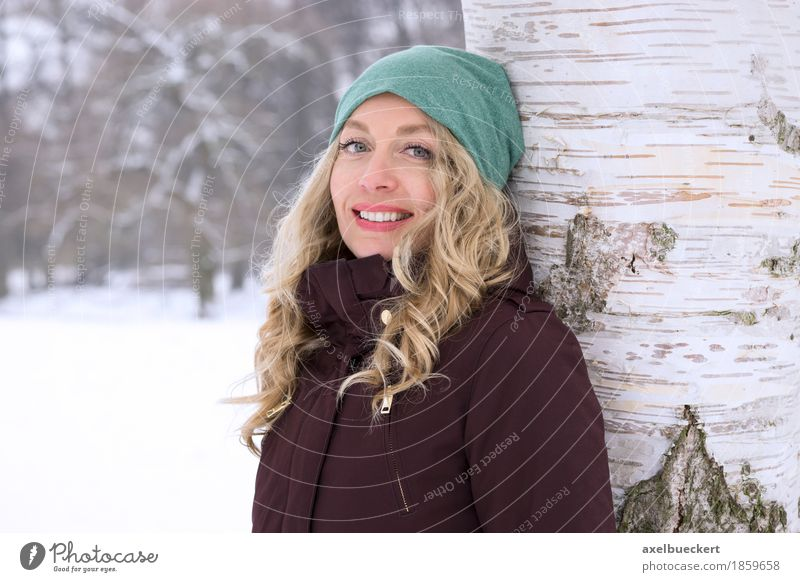 happy woman leaning against tree in winter Lifestyle Leisure and hobbies Vacation & Travel Winter Snow Winter vacation Human being Feminine Young woman