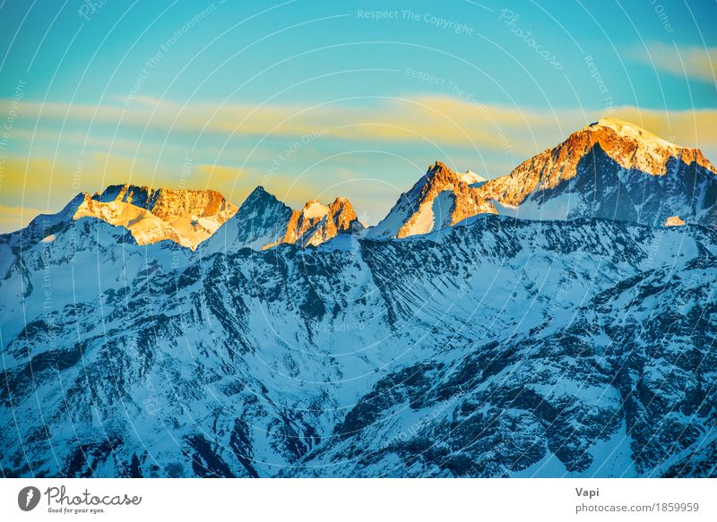 Sunset in whiter mountains with snow Sky Nature Vacation & Travel Blue Beautiful White Sun Landscape Red Clouds Winter Mountain Yellow Sports Snow Rock
