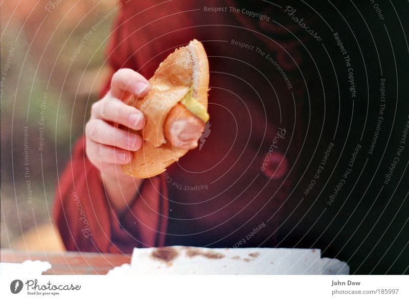 Bockwurst (100) Sausage Nutrition Eating Lunch Fast food Finger food Hand Fingers Human being Jacket Coat Buttons To hold on Delicious Appetite Roll Blur