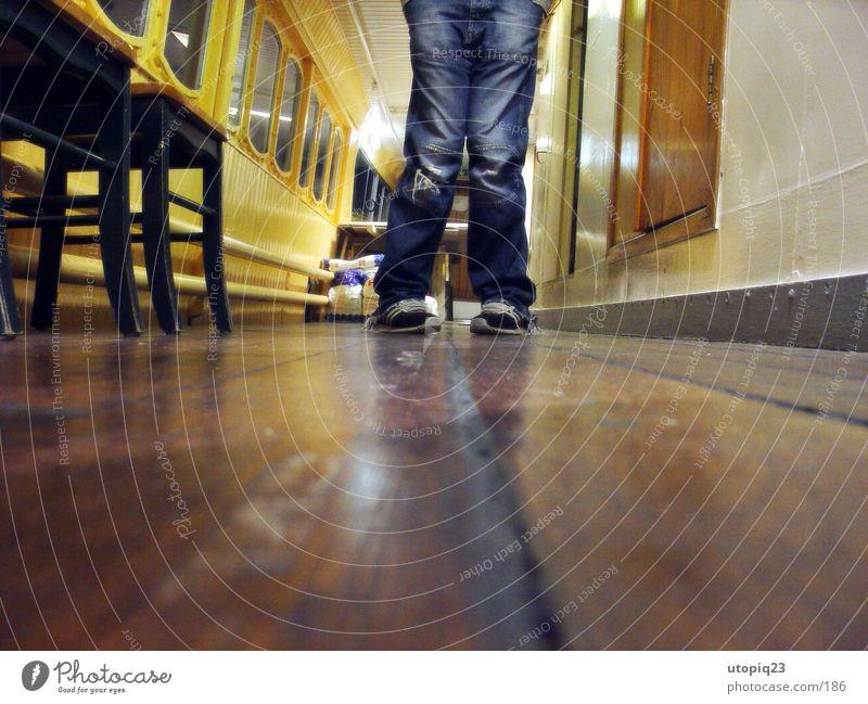 Man Footwear Legs Watercraft Worm's-eye view Jeans Chair Hallway Plank Knock-kneed