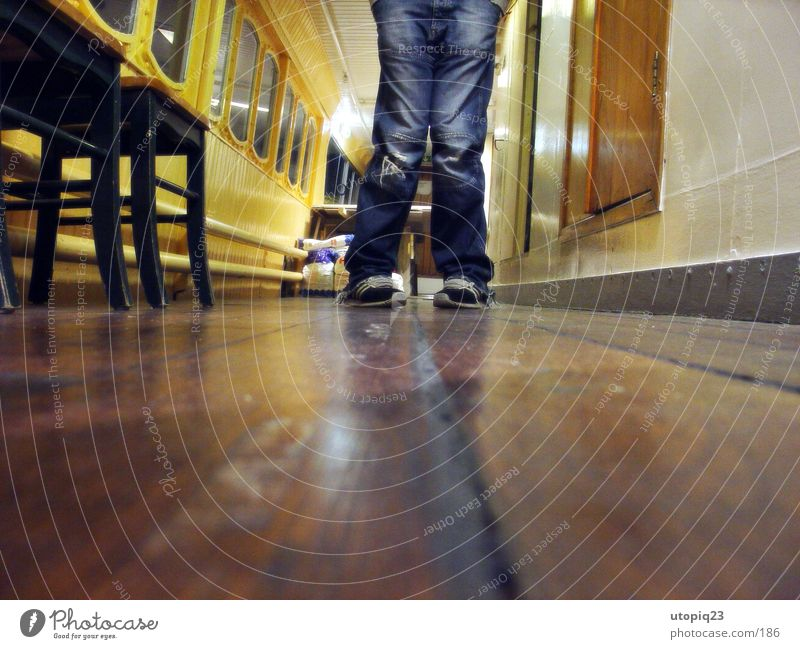Worm's-eye view 2 Footwear Plank Reflection Watercraft Man Legs Jeans Hallway Chair Knock-kneed Corridor