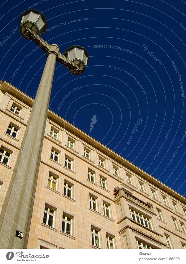 Stalinallee stalinallee Karl-Marx-Allee Lantern Building residential building sugar cake style Sky Blue Facade Tile Window Street lighting Pole