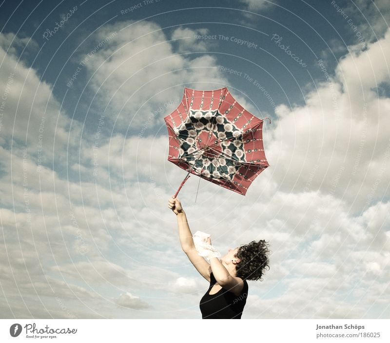 young woman with red umbrella stretches her arms in the blue sky for joy Lifestyle Joy luck Contentment Success Human being Feminine Young woman