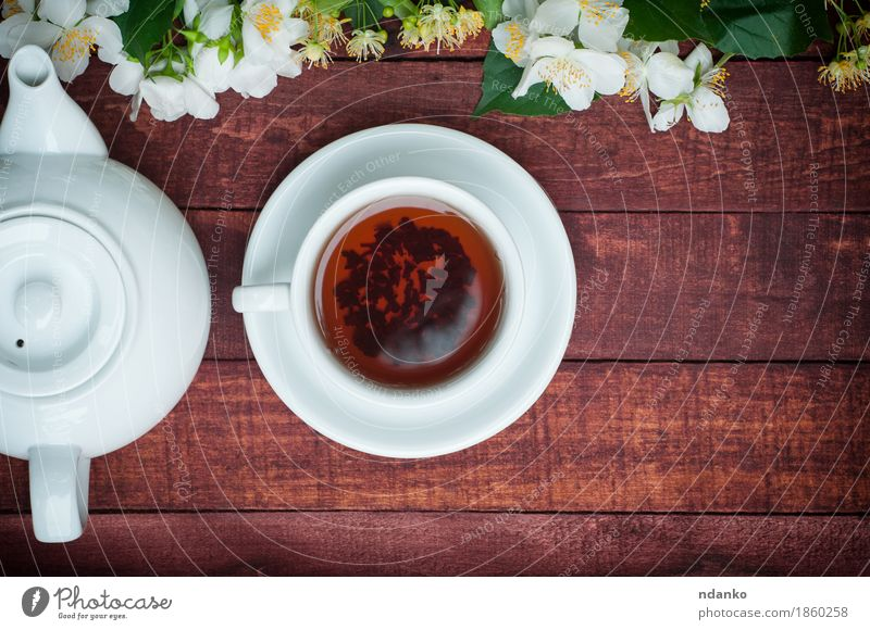 cup of black tea with a teapot and jasmine branches Breakfast Beverage Hot drink Coffee Tea Mug Table Plant Flower Leaf Blossom Wood Blossoming Fresh Brown