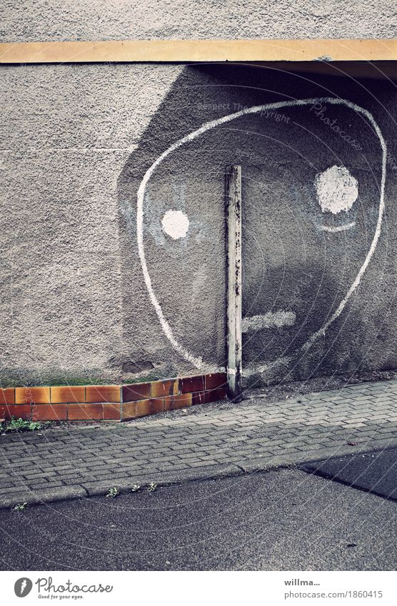 niche existence Subculture Wall (barrier) Wall (building) Sidewalk Sign Graffiti Smiley Gray Town Niche Eyes Face Earmarked Graphic Sadness Rod Prop Brick
