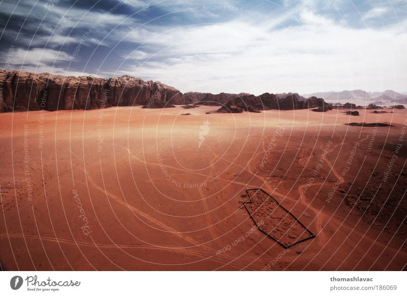 Wadi Rum desert Environment Nature Landscape Sand Sky Clouds Beautiful weather Warmth Hill Rock Mountain Desert Vacation & Travel Cemetery Red Colour photo