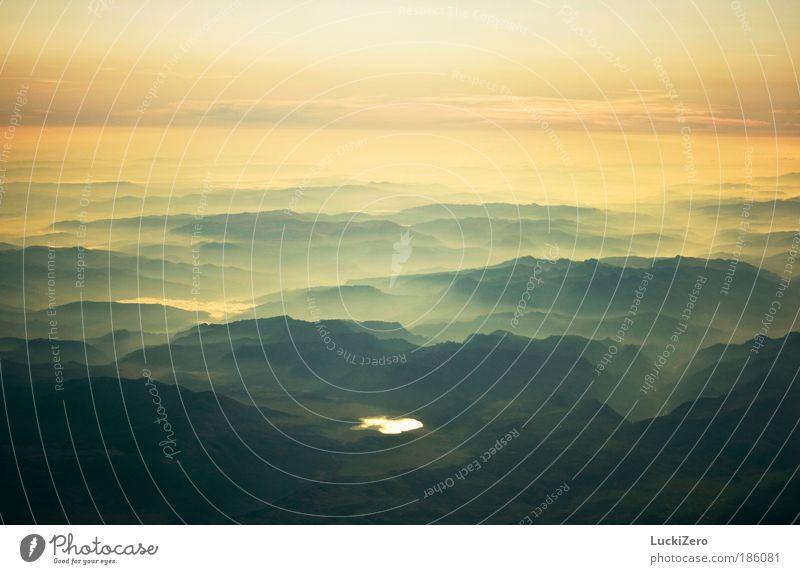Wonderful Earth Harmonious Relaxation Calm Far-off places Freedom Mountain Nature Landscape Elements Air Sky Horizon Fog Peak Lake Deserted Blue Yellow Green