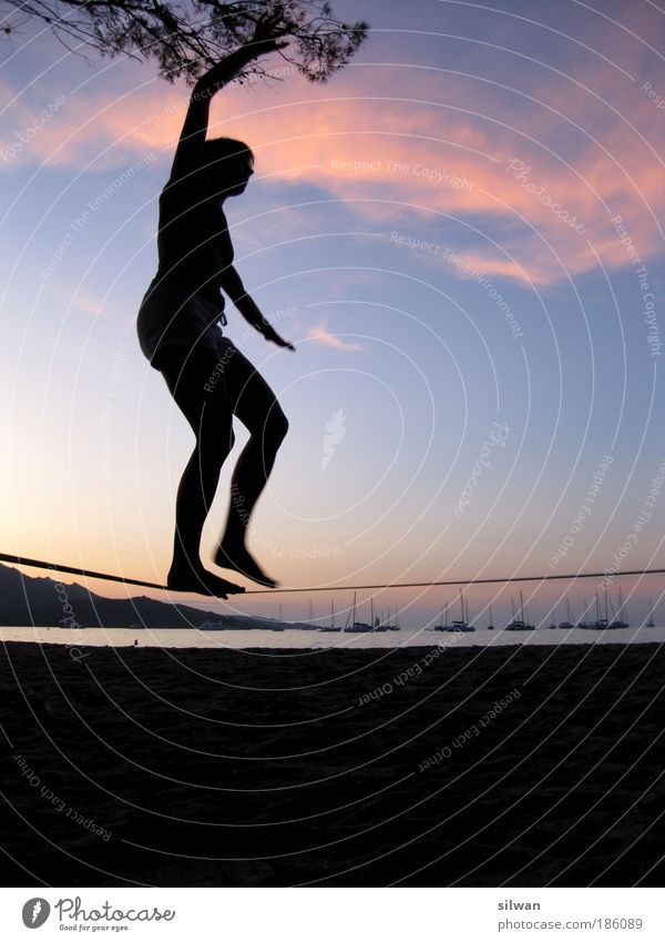 Silhouette young woman on slackline on the beach Slacklining Vacation & Travel Summer Summer vacation Beach Ocean Human being Young woman Youth (Young adults)
