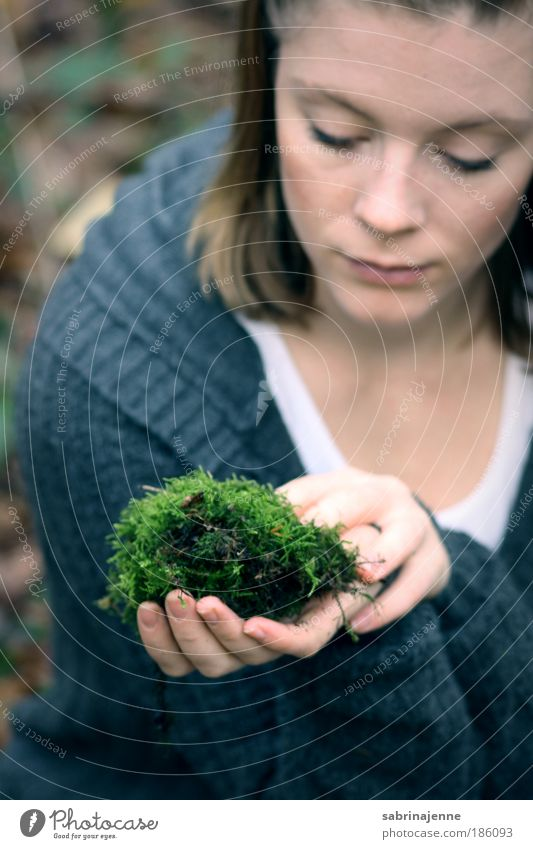 a piece of green Human being Feminine Young woman Youth (Young adults) Hand 1 18 - 30 years Adults Moss Forest Jacket Blonde Blue Green Black Colour photo