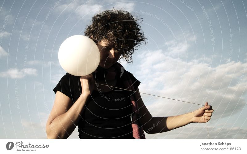 young woman with curls with balloon like clockwork Lifestyle Style Human being Feminine Young woman Youth (Young adults) 18 - 30 years Adults Sky Clouds