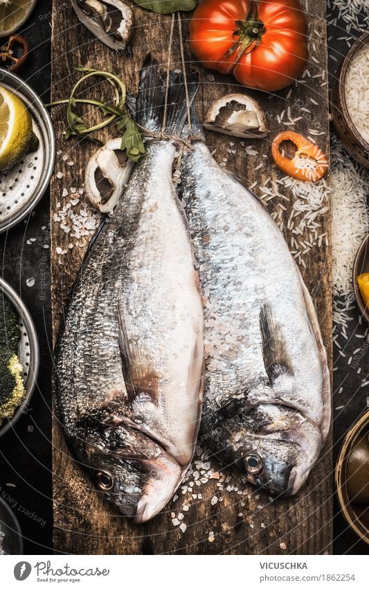 Two Dorado fish with cooking ingredients Food Fish Vegetable Herbs and spices Cooking oil Nutrition Lunch Dinner Banquet Organic produce Vegetarian diet Diet