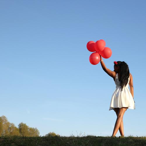 . Feminine Woman Adults 1 Human being Sky Cloudless sky Autumn Beautiful weather Meadow Dress Jewellery Black-haired Long-haired Balloon Movement Going Stand