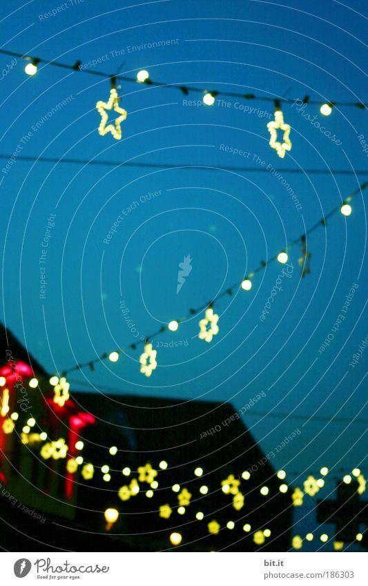 Sky Blue Christmas & Advent Joy Winter Yellow Lighting Feasts & Celebrations Gold Glittering Electricity Star (Symbol) Kitsch Fairs & Carnivals Dusk Hang