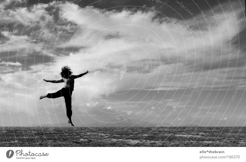 ... juMpiNG ... Lifestyle Leisure and hobbies Human being 1 Sand Sky Sunlight Desert Movement Fantastic Crazy Black White Moody Enthusiasm Optimism Esthetic
