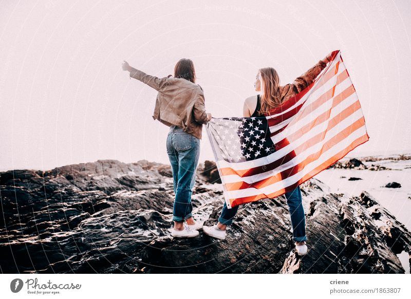 Teenage Girls cheering with USA flag Woman Vacation & Travel Youth (Young adults) Summer Young woman Ocean Joy Beach Adults Lifestyle Freedom Feasts & Celebrations Rock Tourism Together Waves