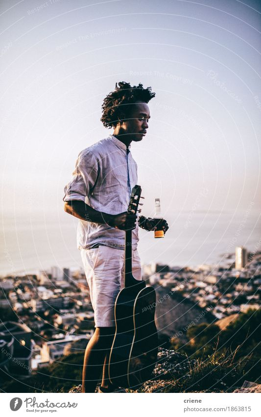 African young men with guitar and beer at outdoor party Human being Vacation & Travel Youth (Young adults) Summer Young man Relaxation Joy Lifestyle