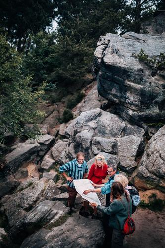 Group of Hikers looking in map Human being Woman Nature Vacation & Travel Youth (Young adults) Man Old Young woman Young man Landscape Relaxation Joy Forest