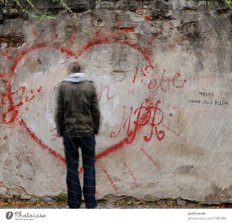 I love you. believe me! Human being Man Adults Wall (building) Sadness Love Graffiti Movement Wall (barrier) Gloomy Stand Heart Broken Romance Longing Jacket