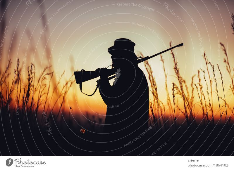 Hunter holding shotgun on shoulder and observing land Nature Man Summer Adults Warmth Meadow Lifestyle Sports Grass Wild Field Protection Male senior Hat Hunting Meat