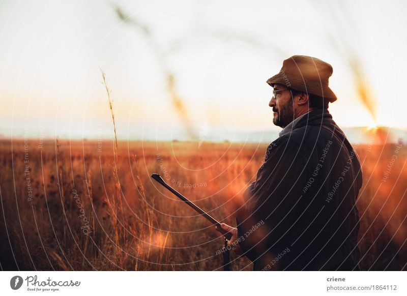 Hunter smiling and satisfied about hunting trip Human being Woman Nature Man Animal Joy Adults Lifestyle Sports Grass Playing Happy Wild Leisure and hobbies Masculine Trip