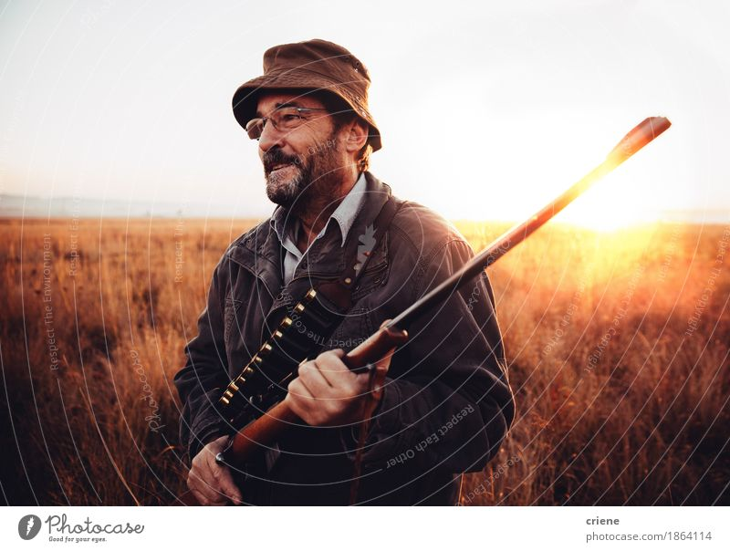 Hunter is happy about his prey he shot in wilderness and smiling Man Landscape Animal Adults Warmth Sports Grass Happy Wild Success Smiling Protection Pasture Farm Passion Agriculture