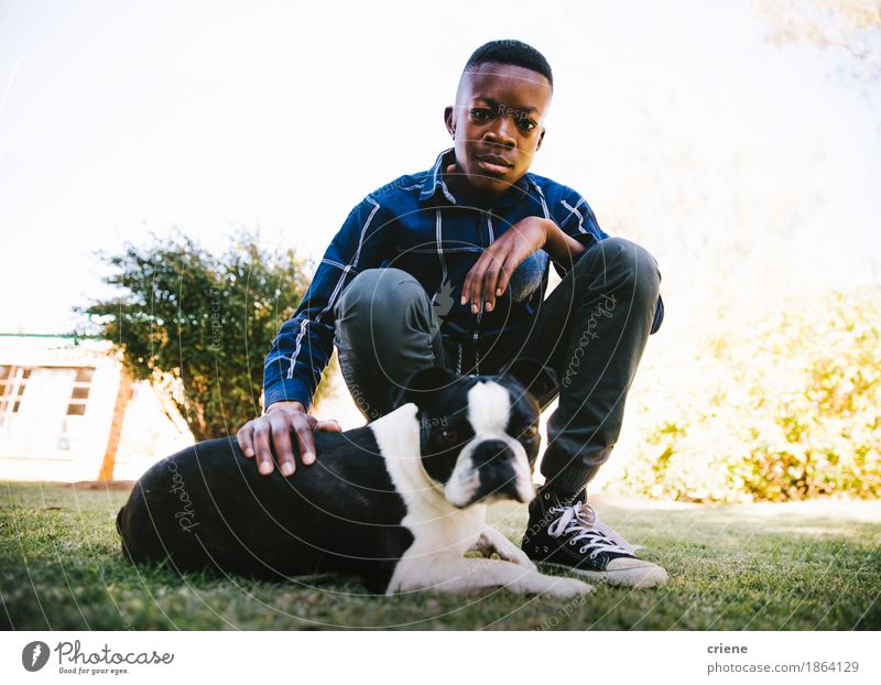 Portrait of male child with his dog on lawn Lifestyle Summer Garden Human being Boy (child) Infancy 8 - 13 years Child Grass Park Meadow Animal Pet Dog