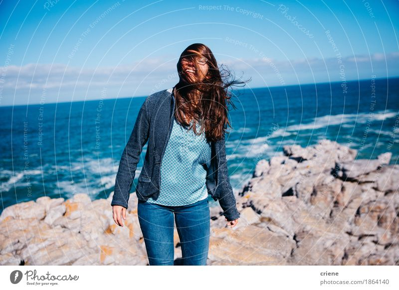 Happy young women standing on cliff by ocean Vacation & Travel Youth (Young adults) Blue Summer Beautiful Young woman Sun Ocean Relaxation Emotions Lifestyle Coast Feminine Laughter Moody Tourism