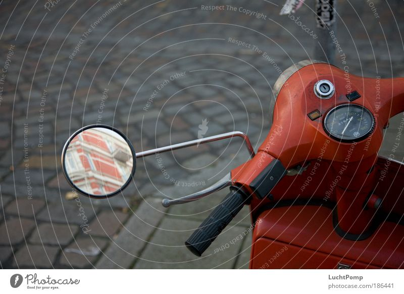 Hibernate. Winter Bad weather Means of transport Road traffic Street Cobblestones Scooter Collector's item Mirror image Red Comfortless Calm Colour photo