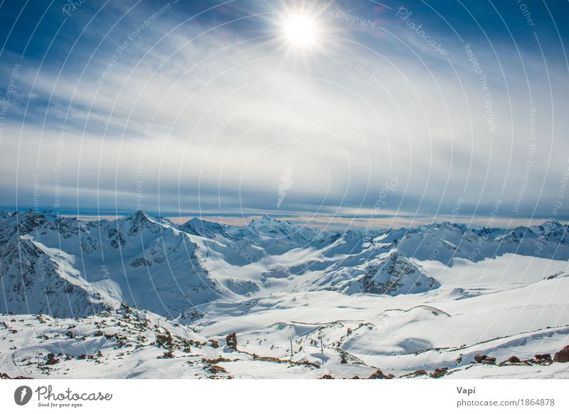Sunset in winter blue mountains with clouds Sky Nature Vacation & Travel Blue White Sun Landscape Clouds Winter Mountain Black Yellow Sports Snow Rock Tourism