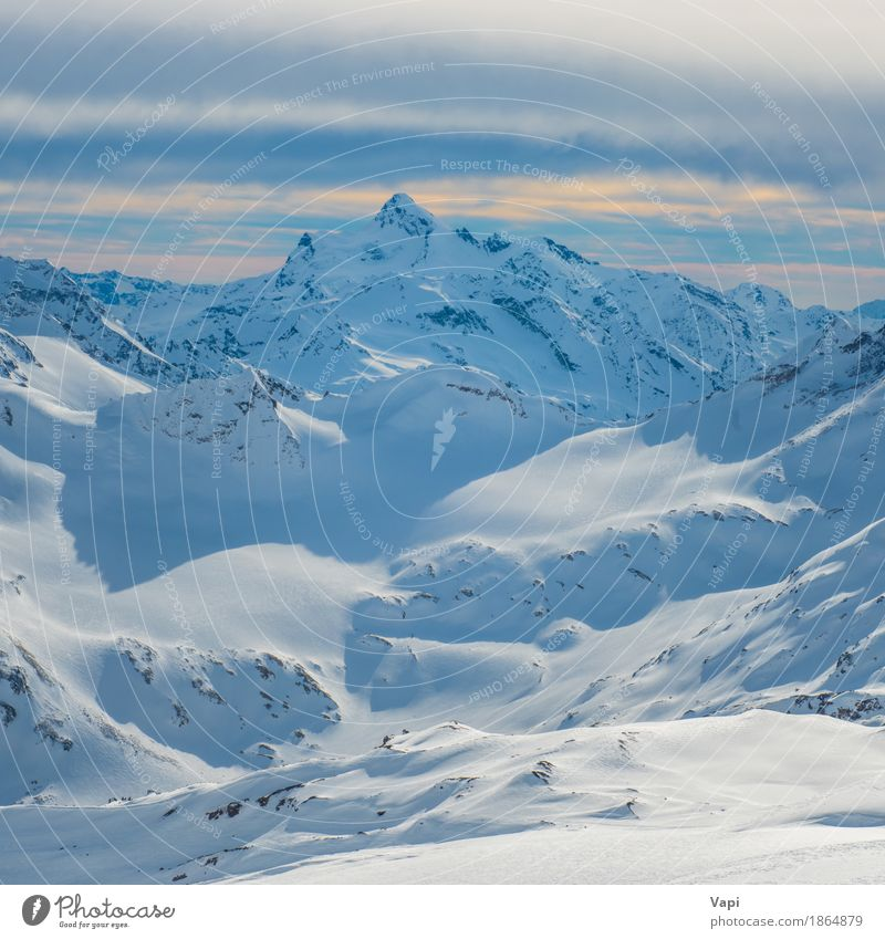 Snowy blue mountains in clouds at sunset Sky Nature Vacation & Travel Blue White Landscape Clouds Winter Mountain Yellow Sports Rock Tourism Orange Ice