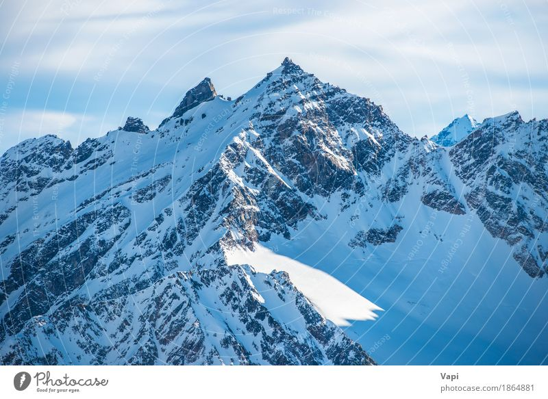 Snowy blue mountain peaks in clouds Sky Nature Vacation & Travel Blue Beautiful White Landscape Clouds Winter Mountain Black Sports Snow Rock Tourism Ice